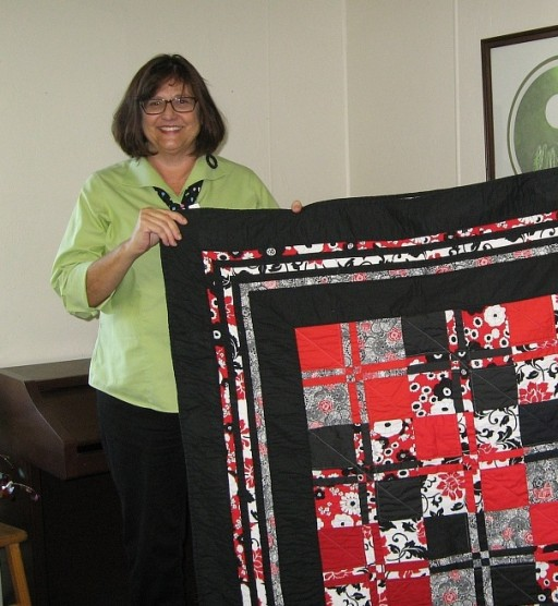 Kris Wagner-Maclean with quilt